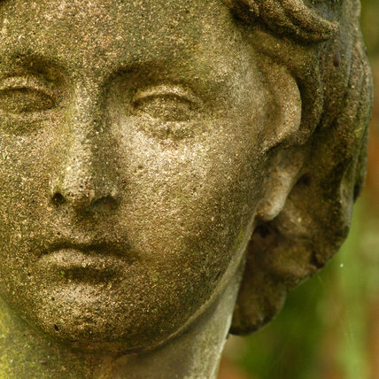 Close view of the head of a garden sculpture at Mottisfont Abbey