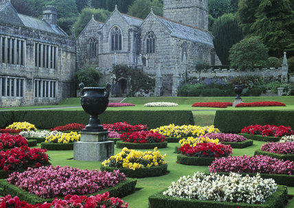 The flower beds to the south of the house, Lanhydrock, Cornwall, in summer with the church in the background