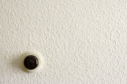 Circular light switch in the upper rooms of the 1970s tailor's shop in the Birmingham Back to Backs
