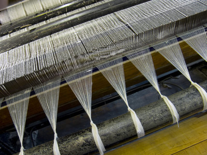 The mechanical loom at Quarry Bank Mill, Styal, showing cotton threads