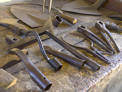 Tools on a bench at Finch Foundry in Devon where agricultural and mining hand tools were produced in the C19th