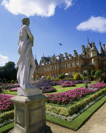 View of Waddesdon Manor with Sculpture in foreground and summer bedding