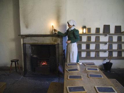 Costumed interpretors in the Apprentice House School Room at Quarry Bank Mill, Styal