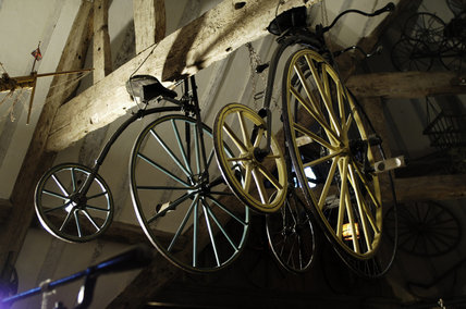Two small penny-farthing bicycles, part of the collection of Charles Wade in Hundred Wheels at Snowshill Manor