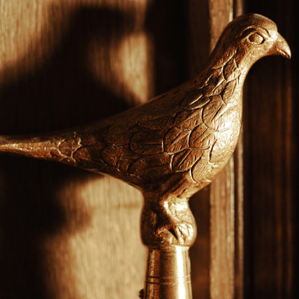 A brass bird tops a staff found in the Lobby at Snowshill Manor, home of collector Charles Wade