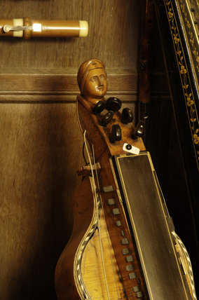 The keys and neck of a hurdy-gurdy, 1840, part of the musical instrument collection of Charles Paget Wade in the Music Room at Snowshill Manor, Gloucestershire