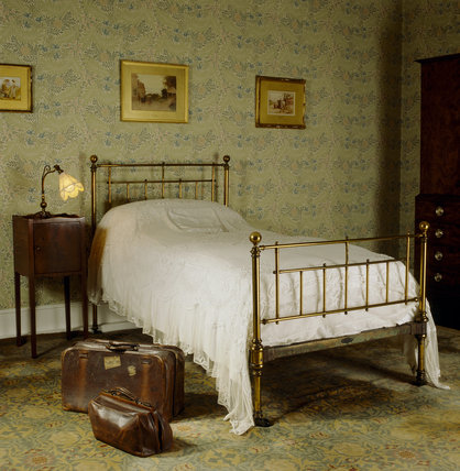 the larkspur bedroom at standen with a bed from heals an old leather