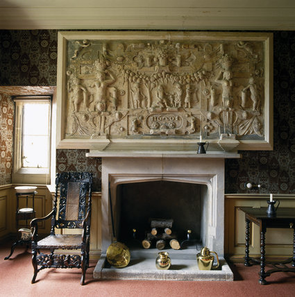 A close up of the fireplace and palsterwork over the mantelpiece in the King Charles Room