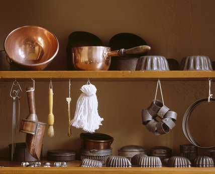 A sugar boiler, flour-mop & baking tins in the Pastry Room cupboard
