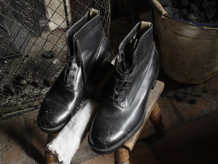 A pair of boots in the 1930s house in the Birmingham Back to Backs