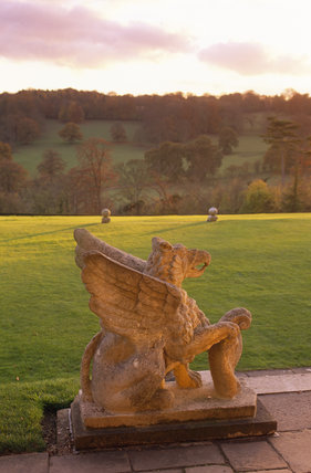 A stone griffin on the south front of Polesden Lacey It is one of a pair, and was installed by Mewes and Davis c