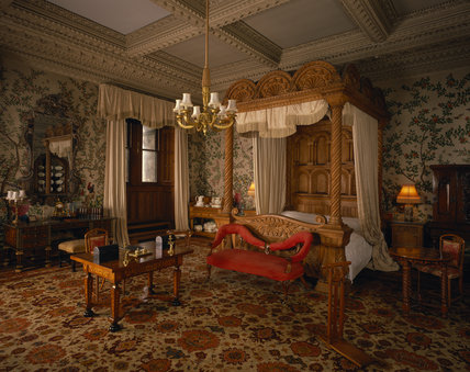 The State Bedroom at Penrhyn Castle showing a massive carved oak bed designed by Hopper
