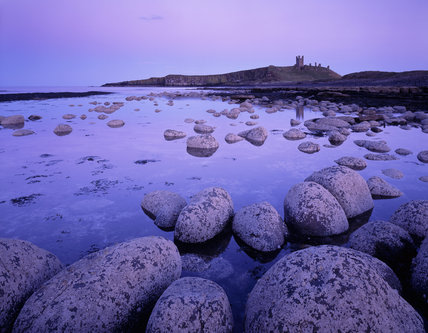 View of Dunstanburgh Castle from the north west taken in the dusk twilight