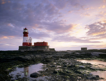 View of Longstone Lighthouse on the Farne Islands taken at sunset
