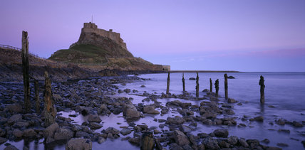 View of Lindisfarne Castle taken from the causeway at low tide