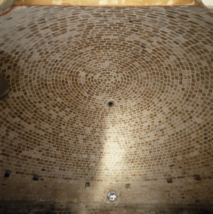 The ice house at Ham House with the brick work laid out in a circular formation