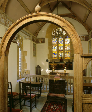 View of chapel with roof renovated by Thomas Lyte 1631, frieze of family's coat of arms, altar, oblong panel Flemish School, stained glass windows installed 1912 by Sir Walter Jenner
