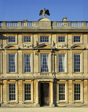 A detailed close up of the East Front of Dyrham Park with the the Blathwayt crest, an eagle, perched on the top