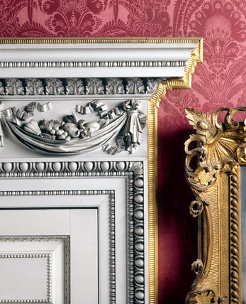 A detailed close up of the richly carved doors, designed by Paine in 1751, for the Drawing Room, where William II hung his larger Grand Tour pictures