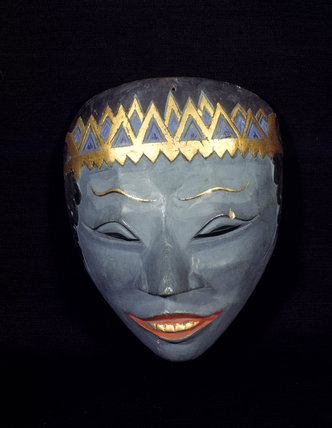 A blue and gold Indonesian mask from Snowshill Manor