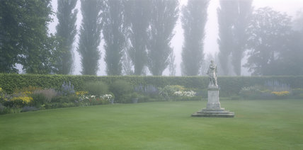 The Herbaceous Garden in mist at Anglesey Abbey in summer
