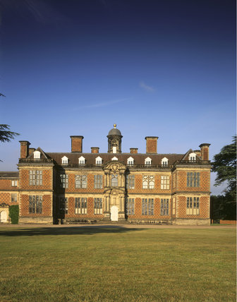 The north front of the Hall standing out against the blue sky