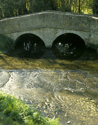 C18th Packhorse bridge in Lacock Village, over the Bide Brook