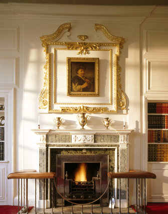 The chimneypiece and gilt overmantel with the painting of a shepherd boy with a pipe in the Library at Mompesson House