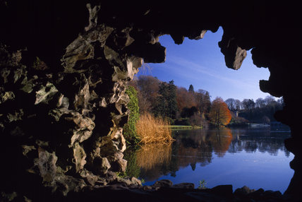 The grotto at Stourhead with autumnal trees & blue skies