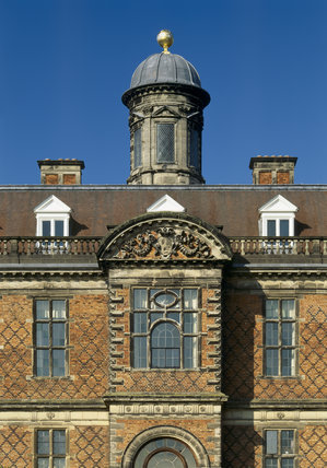 Detail of the south front with the ornate window over the door and the cupola above topped by a golden ball