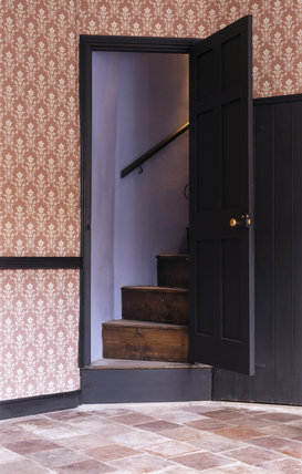 A staircase leads from the 1880s Living Room at the Birmingham Back to Backs