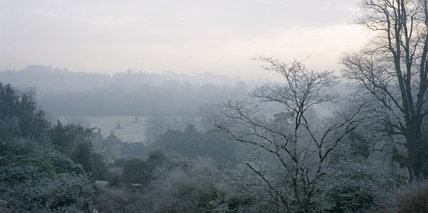 View through frosty tree branches towards the castle at Scotney Castle Garden