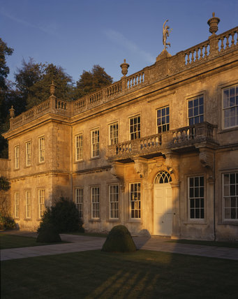 The evening sun shines down on the West Front of Dyrham Park