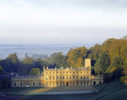 A raised view of the East Front of Dyrham Park and surrounding countryside on a beautiful Autumn's day