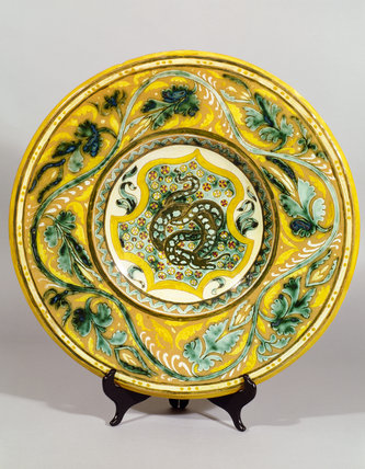 Della Robbia majolica charger in the Morning Room at Standen, with a dragon in the centre