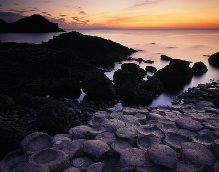 Sunset view of bays, headlands and rock structure at The Giant's Causeway
