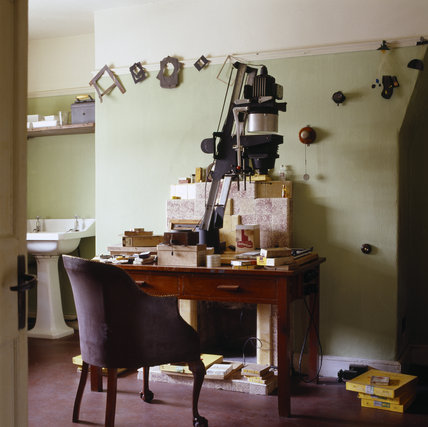 The Dark Room at 59 Rodney Street, Liverpool, the E. Chambre Hardman Studio, House and Photographic Collection - showing a desk, chair and enlarging equipment.