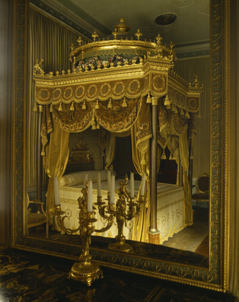 The State Bed at Osterley Park reflected in a mirror, in the State Bedroom