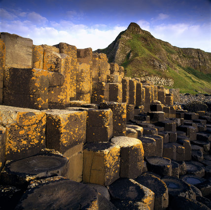 Hexagonal shaped rocks of Giant's Causeway with light reflecting on the different levels of rocks