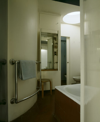 View of the bathroom at 2 Willow Road, top-lit by a circular skylight