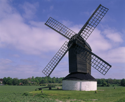 A frontal view of the Mill silhouetted against the cloudy blue sky