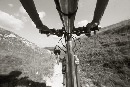 A close-up of a cyclist on his mountain bike at Fulking Escarpment at Devil's Dyke Estate