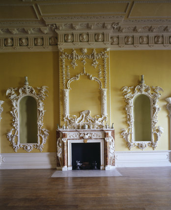 View of the fireplace, overmantel and pair of niches on either side