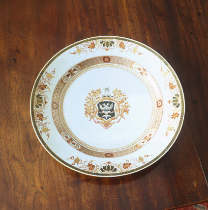 A close-up detail of a plate in the Little Dining Room at Stourhead from the Chinese Armorial dinner service with coat of arms