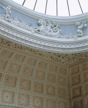 Detail of the frieze beneath the glass dome in the staircase hall