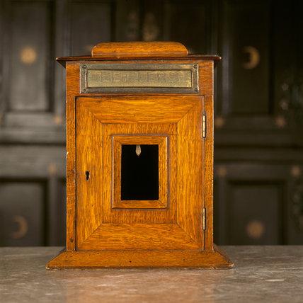 A close-up of a post box at Calke Abbey