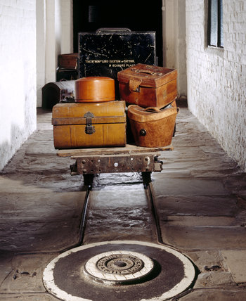 Trolley with suitcases behind the turntable in the corridor at Tatton Park