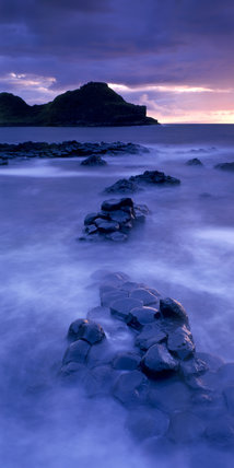 Sunset view of the Giant's Causeway, Co Antrim, the only World Heritage Site in Ireland, with time delay photography creating the impression of mist in the foreground