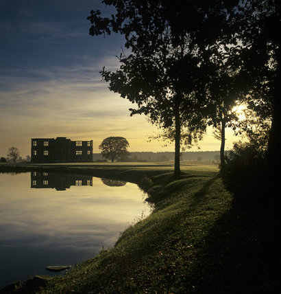 An atmospheric shot of Lyveden New Bield, taken past the lake