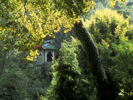 Almost hidden amongst the trees, this ornamental Joss House is perched at one end of a 'Great Wall of China' in the Victorian 'China' garden at Biddulph Grange